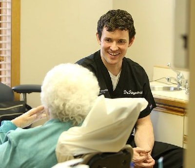 Doctor talking with patient and smiling